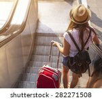 young girl with suitcase down... | Shutterstock . vector #282271508