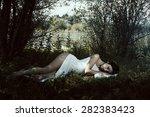 Pale Woman In White Dress Lying ...