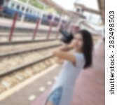 blurred woman using a camera on ...   Shutterstock . vector #282498503