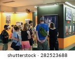 Small photo of HO CHI MINH, VIETNAM - JULY 15, 2014: Unidentified tourists watch photographs at the War Remnants Museum relating to Agent Orange. This herbicide was used by the U.S. military during the Vietnam War.