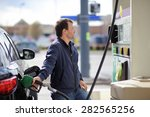 man filling gasoline fuel in... | Shutterstock . vector #282565256