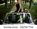 happy couple enjoying a ride on ... | Shutterstock . vector #282567746