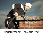 Chimney Sweep Man In Work...