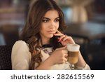 beautiful girl in the city   Shutterstock . vector #282615569