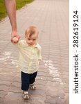 father and son walking hand in...   Shutterstock . vector #282619124