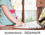 Child using laptop at home. Little girl play some computer game or watching a cartoons - stock photo