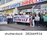 Small photo of HASTINGS, ENGLAND - MAY 30, 2015: Protestors demonstrate against zero hour contracts outside a branch of the Sports Direct sports shop after an anti austerity march through the town.