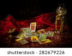 A Pile Of Tarot Cards Lie...