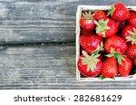 ripe strawberries in wooden box ... | Shutterstock . vector #282681629
