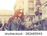 urban girl writing a message. | Shutterstock . vector #282685043