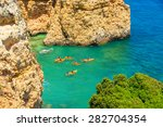 Kayaks On Turquoise Sea Water...