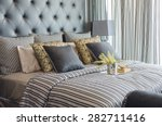 Stock photo tray of book with vase of plant on bed in luxury black bedroom at home 282711416
