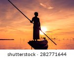 Silhouette Of Fishermen