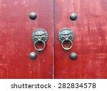 Ancient Door Knocker With The...