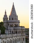 Small photo of BUDAPEST, HUNGARY - MAY 9 2014: Fishermen Bastion in Budapest. Conical towers from Castle Hill, are an allusion to the tribal tents of the early Magyars. Budapest on the background.