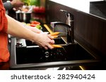 woman washing carrots in the... | Shutterstock . vector #282940424
