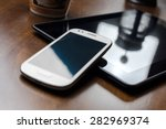 smartphone leaning on tablet... | Shutterstock . vector #282969374