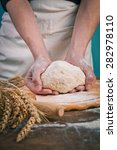 making dough by mens hands on...   Shutterstock . vector #282978110