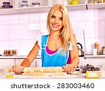 young happy family cooking at... | Shutterstock . vector #283003460