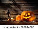 Stock photo halloween pumpkin head jack lantern on wooden background 283016600