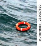 Orange Life Buoy On The Waves...