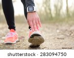 runner stretching leg before... | Shutterstock . vector #283094750