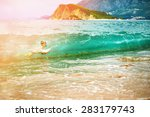 boy floats on the sea waves at... | Shutterstock . vector #283179743