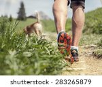 Stock photo man legs on the mountain footpath close up image 283265879