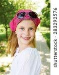 happy girl is in a amusement... | Shutterstock . vector #283292576
