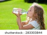 child drinking water. girl... | Shutterstock . vector #283303844