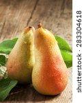 Two Ruddy Long Yellow Pears...