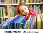 little girl is choosing a book...   Shutterstock . vector #283313963