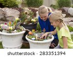 Two Young Girls Helping To Mak...