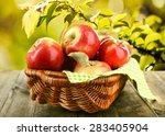 Wicker Basket Of Red Apples...