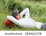 young woman relaxing in grass... | Shutterstock . vector #283462178