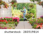 Side View Of Gardener Carrying...