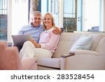 mature couple at home in lounge ... | Shutterstock . vector #283528454