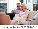 mature couple at home in lounge ... | Shutterstock . vector #283528460