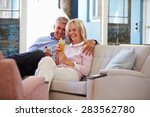 mature couple at home relaxing... | Shutterstock . vector #283562780