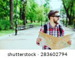 a young tourist with a beard... | Shutterstock . vector #283602794