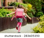 Little Girl With A Backpack Ru...