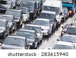 Cars Cueing In City Traffic In...