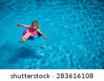 happy child playing in swimming ... | Shutterstock . vector #283616108