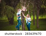 happy family with wooden... | Shutterstock . vector #283639670