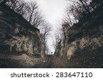 man on path between cliffs | Shutterstock . vector #283647110