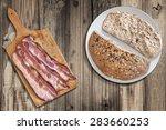 Three Pork Belly Rashers On Old ...