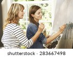 female artist teaching pupil in ... | Shutterstock . vector #283667498
