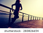 sports woman running on wooden... | Shutterstock . vector #283826654