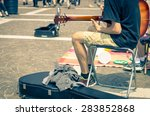 Street Artist Plays Guitar  ...