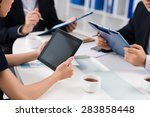 Women Sitting With Touchpad At...